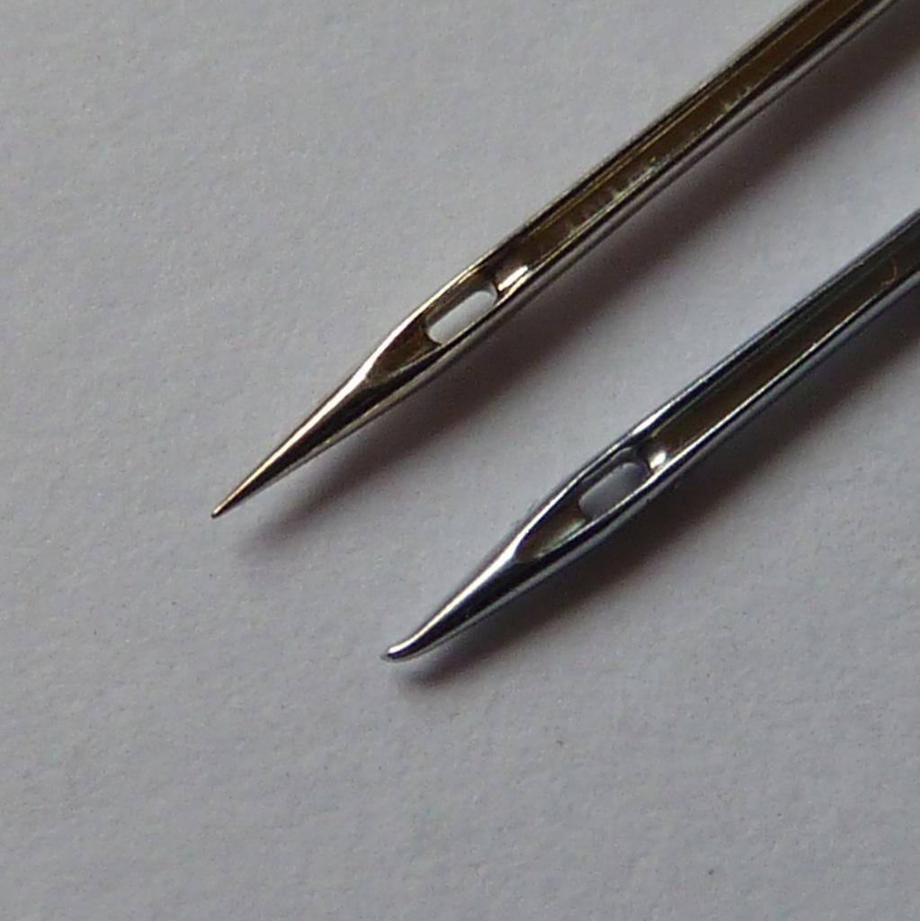 Damaged overlocker needle with new universal needle