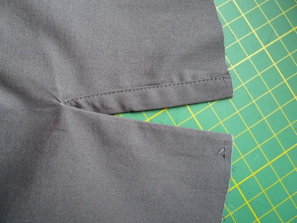 Binding on sleeve slashes