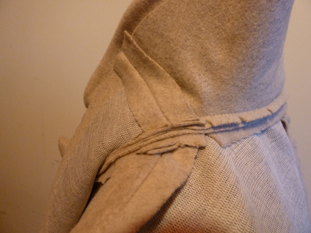 Trimming seams under collar facing