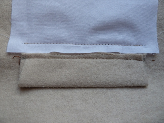 Under pocket bag sewn to right side\