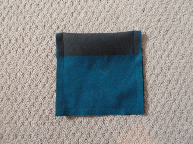 Pocket folded in half and stitched around edges