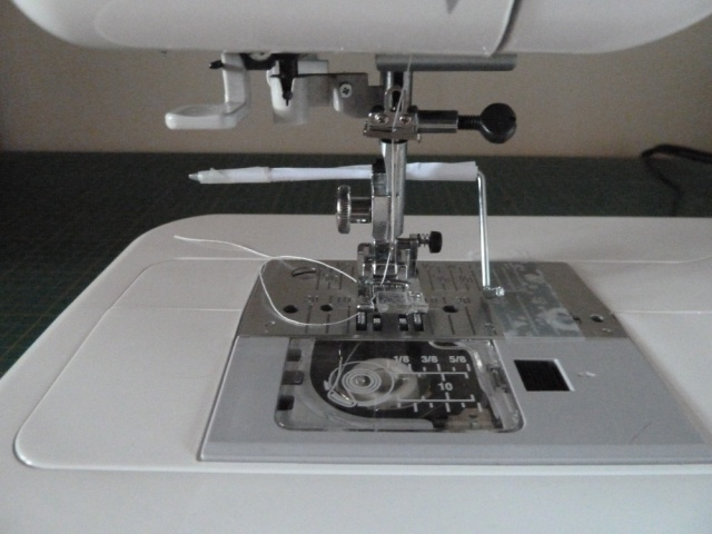 Sewing machine with quilt guide wrapped in paper