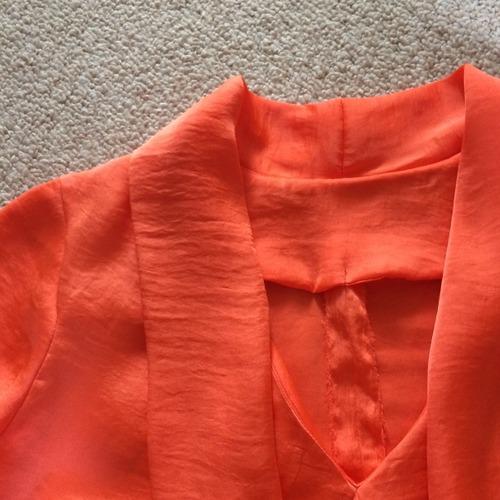 Facings on orange x-wrap dress