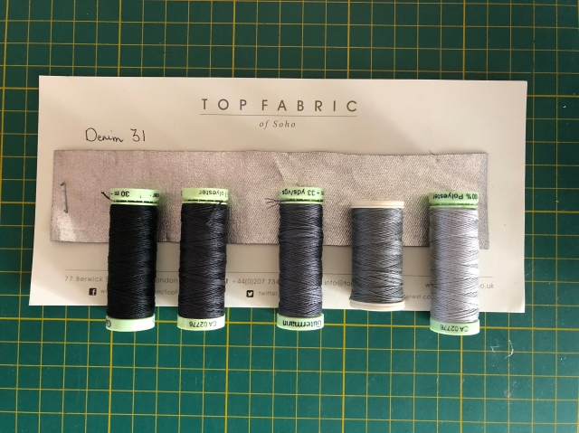 Silver fabric sample with various top stitching threads
