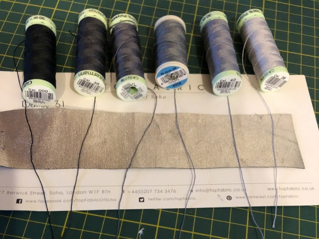 Various grey topstitching threads against silver foiled denim