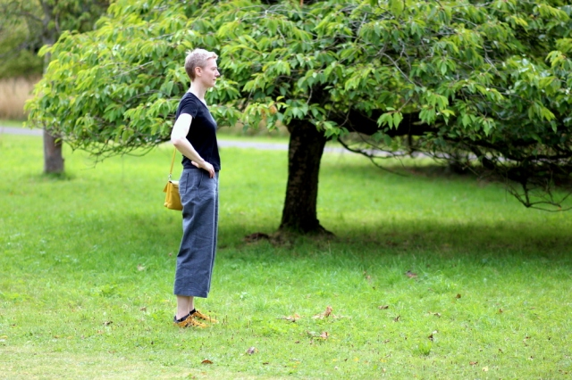 Burda 112A 03/2012 culottes in dark silver denim, side full length view, in botanic garden