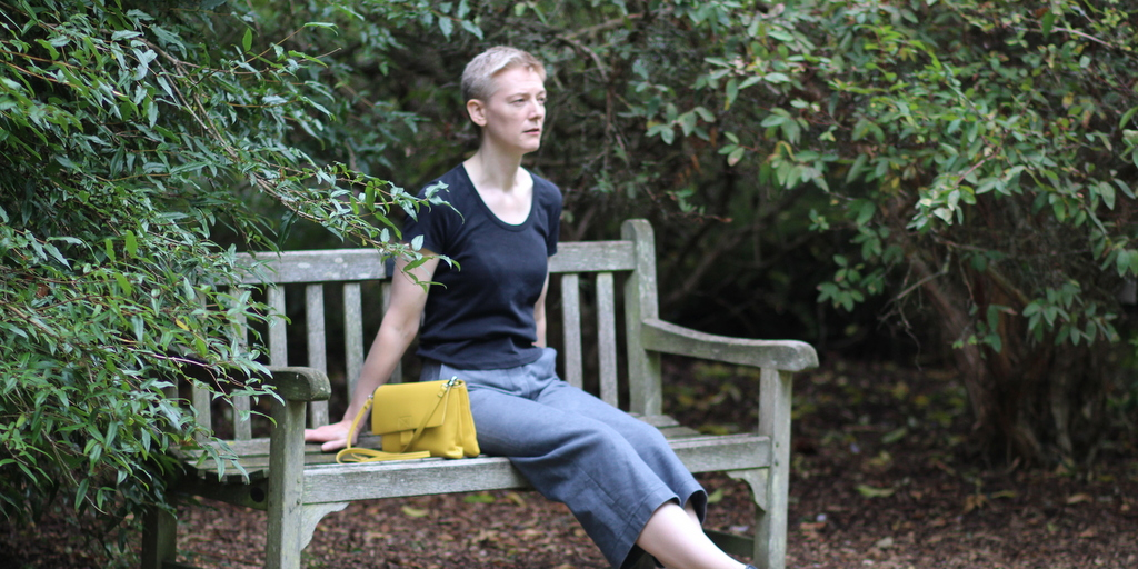 Burda 112A 03/2012 culottes in silver grey denim, seated, in botanic garden