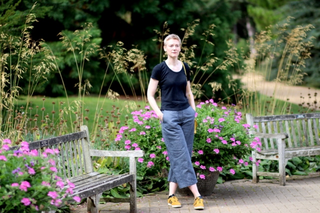 Burda 112A 03/2012 culottes in dark silver denim, front view, in a botanical garden