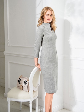 Model photo of Burda 116 09/2018. Blonde woman wearing fitted grey dress.