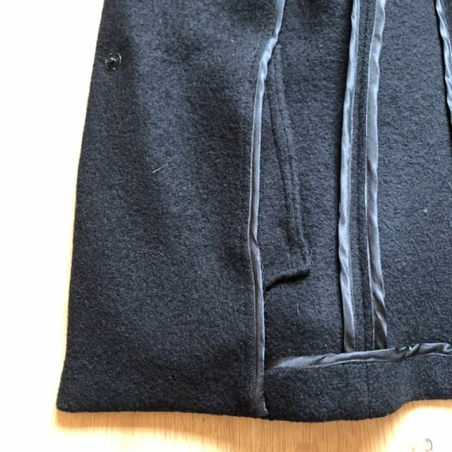 The inside of an unlined jacket (Vigue 1466) showing front facing and pocket bag