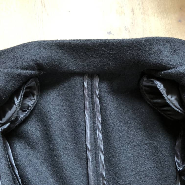 The inside of an unlined jacket (Vogue 1466) showing bound seams and covered shoulder pads