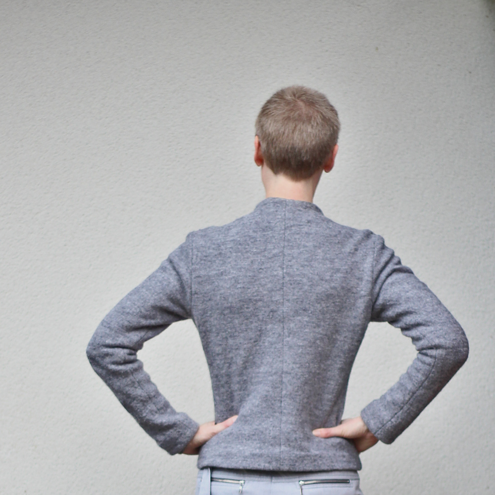 Back view of a woman with short hair wearing a grey jumper